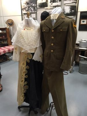 Traditional Marie Clare outfit and a First Filipino Regiment uniform. Note the volcano emblem on the sleeve.