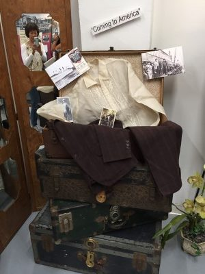 The immigrant's suitcase - full of dreams and memories of home.