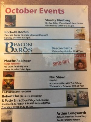October events under glass at the entrance of Third Place Books.