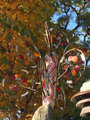 Found art of bicycle wheels makes a lovely tree.